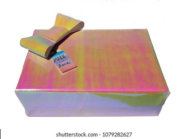 isolated colorful holographic foil present with bow and tag