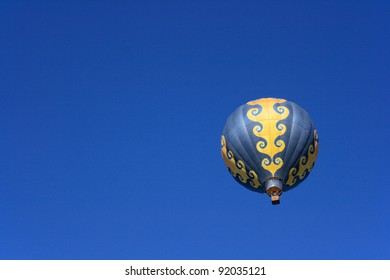 Isolated colorful hot air balloon floating in the sky