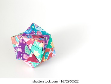 Isolated and colorful origami sonobe octahedron cube.