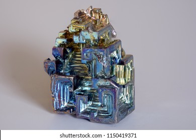 Isolated colorful synthetically synthesized bismuth crystal as a representation of the chemical element in the periodic table of elements