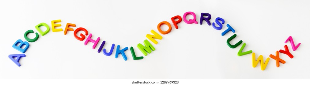 Isolated colorful wooden letters on white background