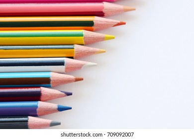 isolated coloured pencils bar on white background