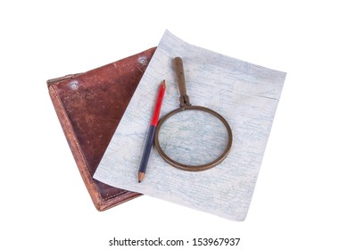 isolated composition of old-style map with magnifier, pencil and leather case