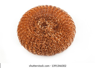 Isolated copper metal sponge for washing dishes on white background