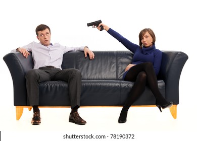 isolated couple on a couch with a gun