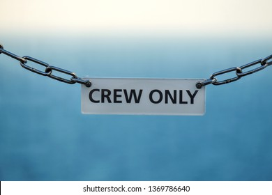 Isolated Crew only sign on a ship with blurred background - only applies to authorized personnel