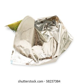Isolated crumpled foil wrapper from just eaten glazed curd