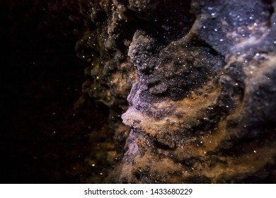 Isolated crystals closeup in the dark cave
