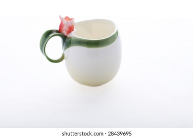 Isolated cup decorated with red flower and green stripe