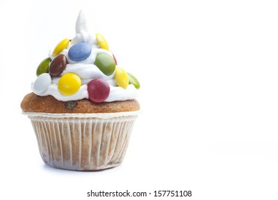Isolated cupcake with candies