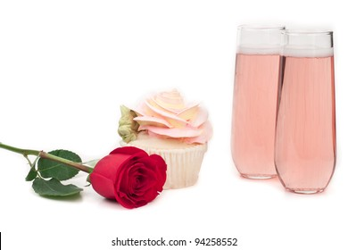 isolated cupcake shape like a rose on a white background with a green leaf a fresh rose and champagne