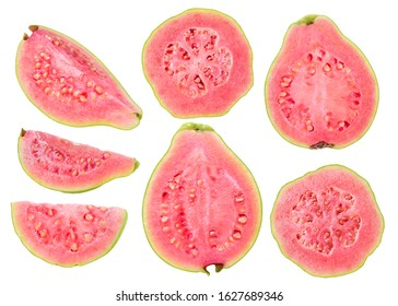 Isolated cut guava fruits. Pieces of green pink fleshed guavas isolated on white background with clipping path