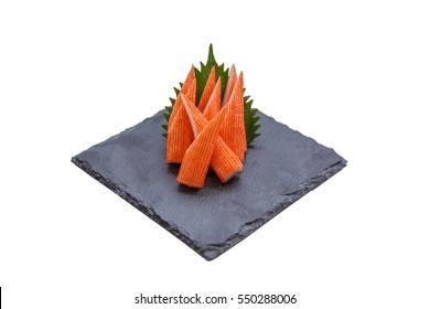 Isolated Cut Kani (Crab Stick) Sashimi Served with Sliced Radish on Stone Plate.