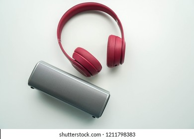 isolated cute pink portable headphone with bluetooth speaker for connections