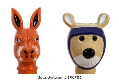 Isolated cute plastic kangaroo and quokka heads.