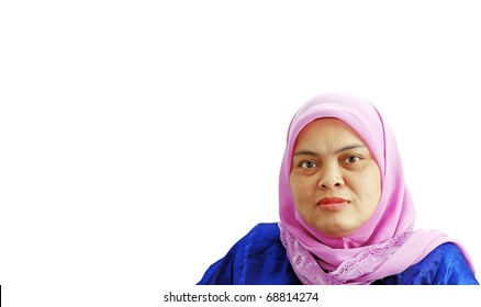 An isolated cutout of a mature Muslim lady wearing a pink head scarf.