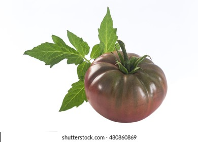 isolated dark red heirloom tomato