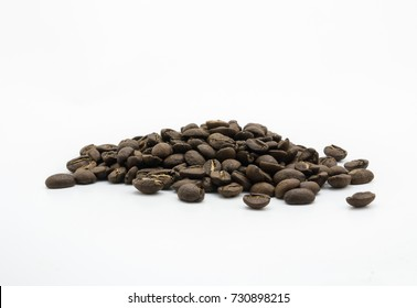 Isolated dark roasted coffee beans on white background