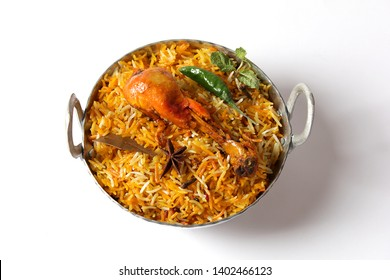 Isolated delicious spicy chicken biryani in white plate on white background, Indian or Pakistani ramzan food. Beautiful view of traditional spicy indian food, Iftar meal, Ramadan dinner.