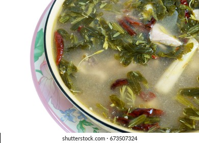 Isolated Dicut photography. Hot and sour soup of chicken with Tamarind leaves.