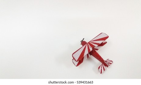 Isolated diecast aeroplane red with white stripe.