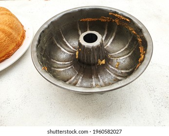 Isolated dirty cake pan.  After it is used to make vanilla cake, it is on a white background.  Copy space and can be used as background.
