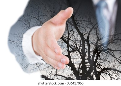 isolated and double exposure of businessman extending hand to shake with Tree branch.
