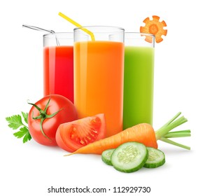 Isolated drinks. Glasses of fresh vegetable juices and cut tomato, carrot and cucumber isolated on white background