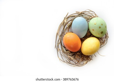 Isolated easter eggs in nest. Top view