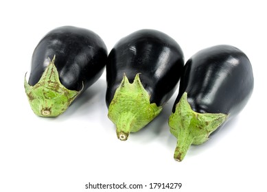 Isolated eggplant with stem over white background