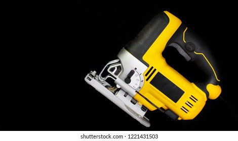 Isolated electric jig saw on a black background
