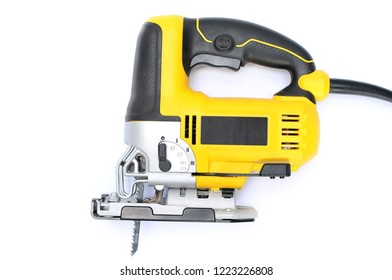 Isolated electric jig saw on a white background with blade