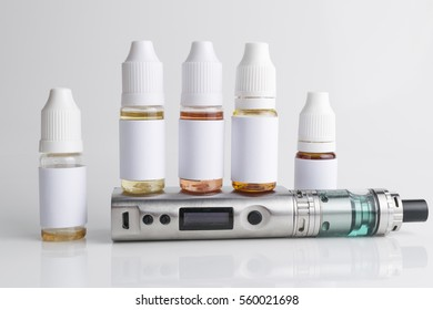 Isolated electronic cigarette with e-liquid or e-juice on a white background.