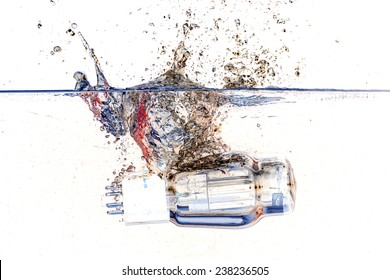 Isolated electronic vacuum tubes valve fall in water with big splash and white background