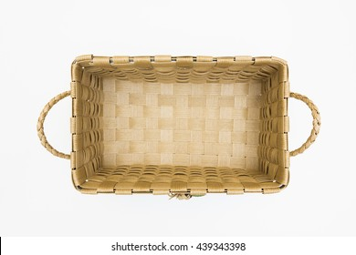 Isolated Empty Brown Wicker Handmade Crafts Basket on White Background View from Top or Above / Eco Friendly Material from Nature