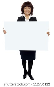 Isolated experienced asian businesswoman holding blank white billboard