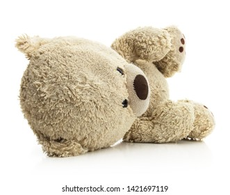 Isolated fallen teddy bear on a white background