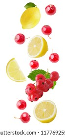 Isolated falling berries. Flying fresh lemon and red currant isolated on white background with clipping path as package design element and advertising.