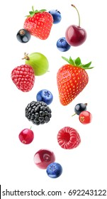 Isolated falling berries. Mixed fruits in the air (blueberry, blackberry, raspberry, strawberry, gooseberry, cherry, black and red currants) isolated on white background with clipping path