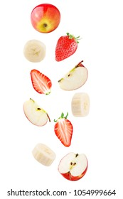 Isolated falling fruits. Falling apple, banana and strawberry fruit isolated on white background with clipping path as package design element.