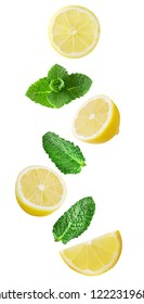 Isolated falling fruits. Flying lemon and mint leaves isolated on white background with clipping path as package design element and advertising.