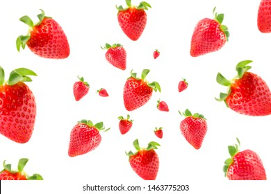 Isolated falling fruits. Photograph of delicious and fresh strawberries flying isolated on white background. Selective focus. Food levitation concept. Creative food layout. High resolution image.