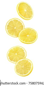 Isolated falling lemon pieces. Slices of lemon in the air isolated on white background with clipping path