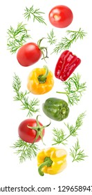 Isolated falling vegetables. Flying fresh sweet pepper and dill isolated on white background with clipping path as package design element and advertising.