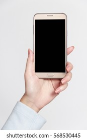 Isolated female hand holding a phone with white background.