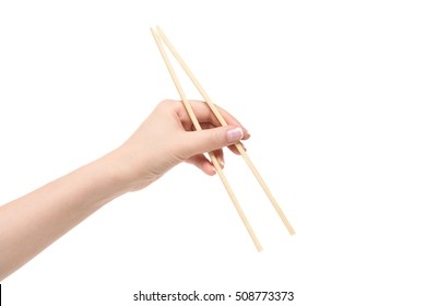 Isolated female hand holds chopsticks on a white background.