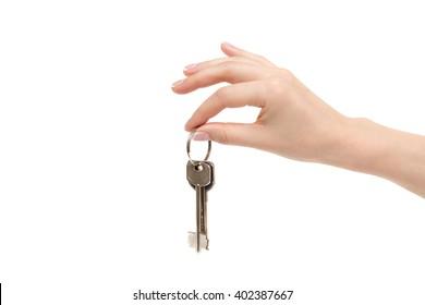 Isolated female hand holds keys on white background.