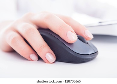 Isolated female hand on the mouse.
