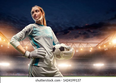 Isolated Female Soccer Goalkeeper on white background. Girl with soccer ball