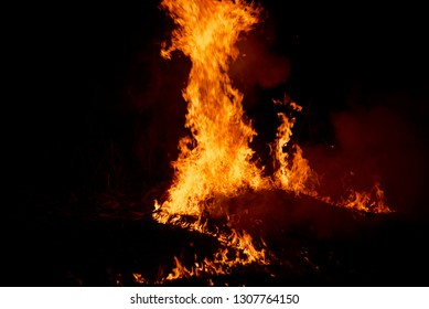 Isolated fire flames with smokes around a place at night